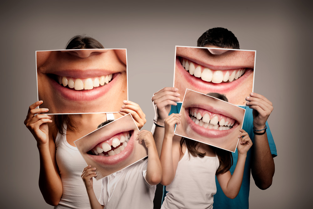 family smlling with healthy teeth
